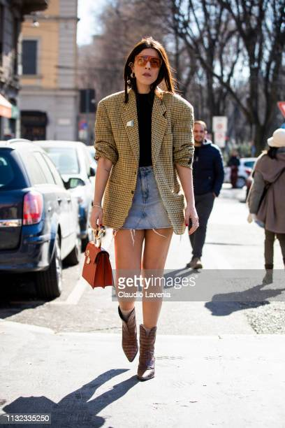 Andria Aletrari checked jacket denim skirt and orange bag and sunglasses is seen outside Laura Biagiotti on Day 5 Milan Fashion Week Autumn/Winter...