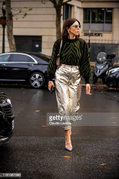 Andria Aletrari, wearing a green zebra print jumper, gold pants and pink decorated heels, is seen outside the Miu Miu show during Paris Fashion Week...