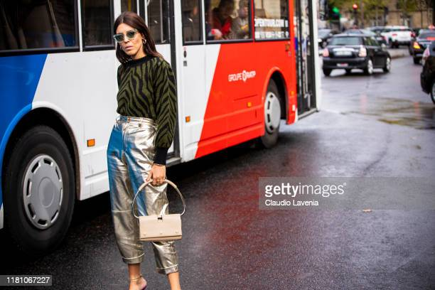 Andria Aletrari wearing a green zebra print jumper gold pants and pink decorated heels is seen outside the Miu Miu show during Paris Fashion Week...