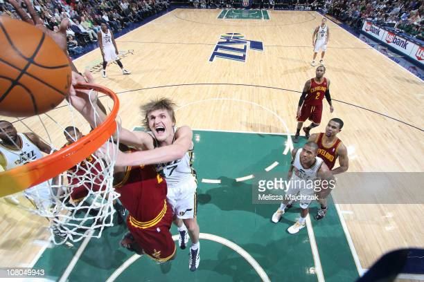 Andrie Kirilenko of the Utah Jazz goes for the layup against JJ Hickson of the Cleveland Cavaliers at EnergySolutions Arena on January 14 2011 in...
