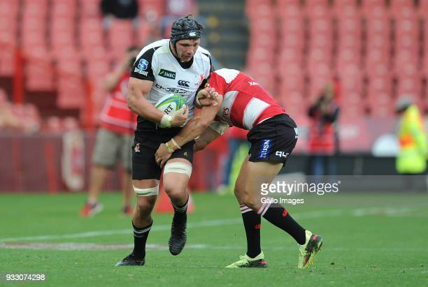 Andries Coetzee of Lions in action with Pieter Labuschagne of Sunwolves during the Super Rugby match between Emirates Lions and Sunwolves at Emirates...