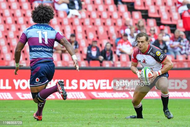 Andries Coetzee of the Lions challenged by Henry Speight of the Reds during the Super Rugby match between Emirates Lions and Reds at Emirates Airline...