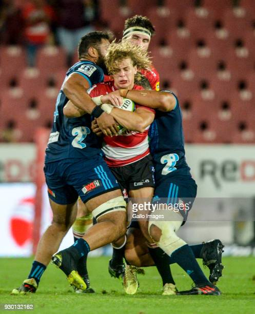 Andries Coetzee of the Lions tackled during the Super Rugby match between Emirates Lions and Blues at Emirates Airline Park on March 10 2018 in...