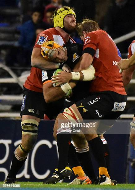 Andries Ferreira of Linos tackles Jeronimo de la Fuente during a match between Jaguares and Lions as part of Super Rugby Rd 17 at Jose Amalfitani...