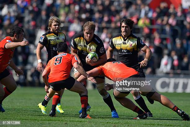 Andries Ferreira of Lions is tackled during the Super Rugby Rd 1 match between Sunwolves and Lions at Prince Chichibu Stadium on February 27 2016 in...