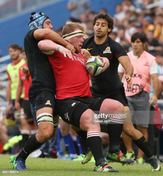 Andries Ferreira of Lions is tackled during the Super Rugby Rd 3 match between Jaguares and Lions at Jose Amalfitani Stadium on March 11 2017 in...
