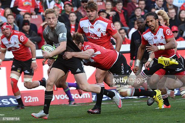 Andries Ferreira of the Lions tackles Johnny McNicholl of the Crusaders during the Super Rugby match between the Emirates Lions and Crusaders at...