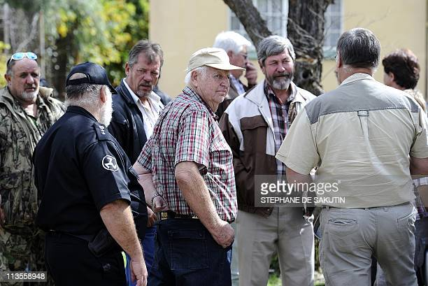 AndriesTerre'Blanche the brother of slain white supremacist Afrikaner Resistance Movement leader Eugene Terre'Blanche arrives with AWB supporters on...