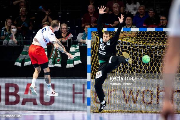 Andrii Akimenko of KS Azoty-Pulawy and Dejan Milosavljev of Fuechse Berlin during the EHF Handball European League match between Fuechse Berlin and...