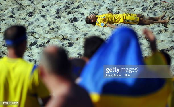 Andrii Borsuk of Ukraine lies dejected in the pitch after loosing the FIFA Beach Soccer World Cup Group D match between Ukraine and Mexico at Stadium...