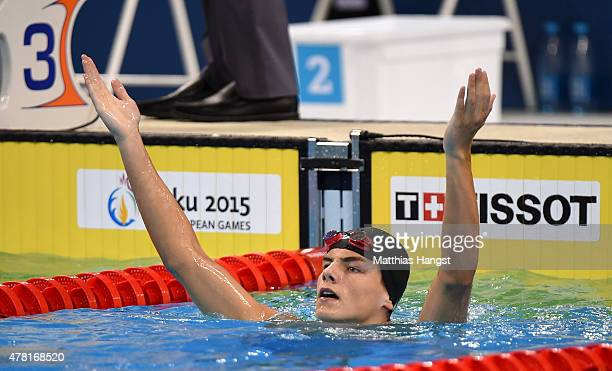 Andrii Khloptsov of Ukraine celebrates winning gold in the Men's 50m Butterfly final during day eleven of the Baku 2015 European Games at the Baku...