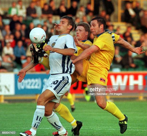 Andrii Shevchenko of Dynamo Kiev gets away from Barry Town players during the European Champions League match at Barry tonight Photo Barry...