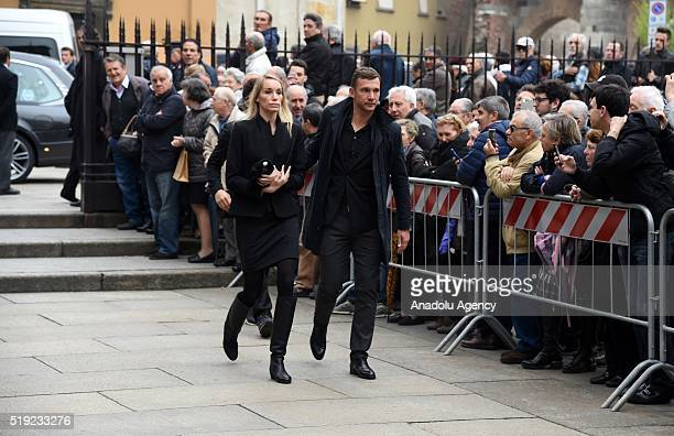 Andrij Shevchenko and his wife Kristen Pazik arrive in the courtyard of Sant'Ambrogio church for the funeral service of Cesare Maldini on April 5...