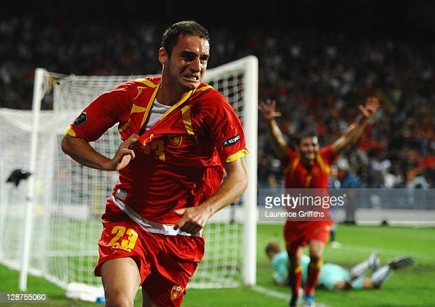 Andrija Delibasic of Montenegro celebrates scoring his team's equalising goal during the UEFA EURO 2012 group G qualifier between Montenegro and...