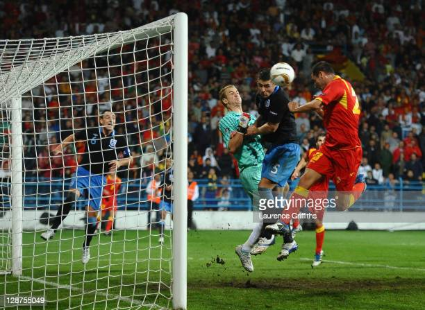 Andrija Delibasic of Montenegro scores his team's equalising goal past Joe Hart of England during the UEFA EURO 2012 group G qualifier between...