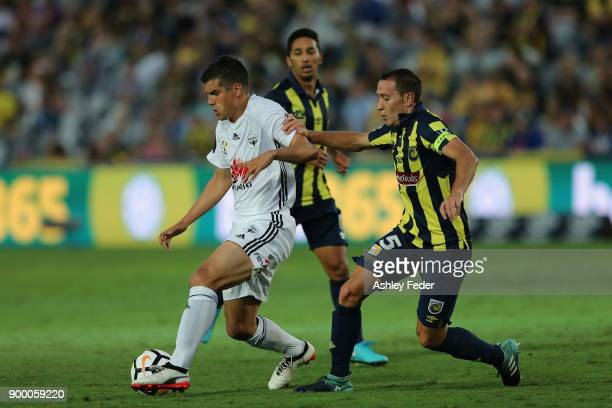 Andrija Kalderovic of the Phoenix contests the ball against Alan Baro and Tom Hiariej of the Mariners during the round 13 ALeague match between the...