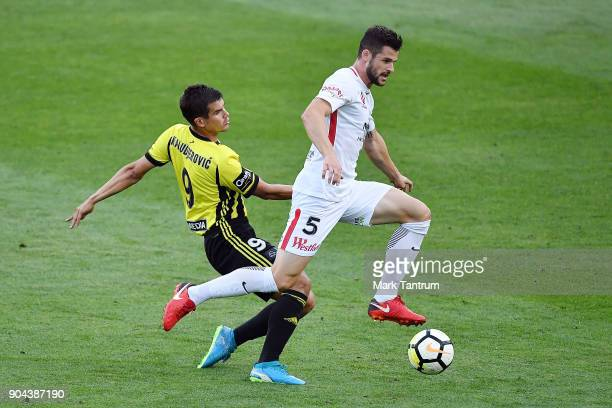 Andrija Kaluderovic of the Wellington Phoenix and Brendan Hamill of the Western Wanderers during the round 16 ALeague match between the Wellington...
