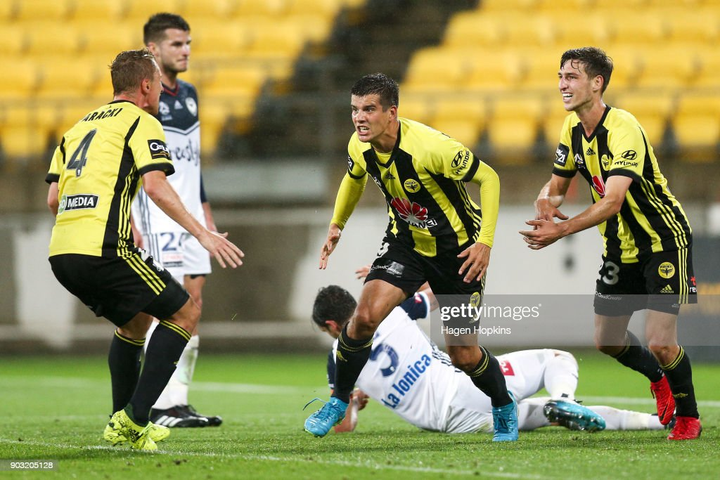 Andrija Kaludjerovic, Goran Paracki and Matthew Ridenton celebrate an own goal by Mark Milligan of the Victory during the round 15 A-League match between the Wellington Phoenix and Melbourne Victory at Westpac Stadium on January 10, 2018 in Wellington, New Zealand.