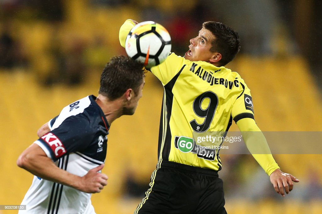 Andrija Kaludjerovic of the Phoenix and Dino Djulbic of the Victory compete for a header during the round 15 A-League match between the Wellington Phoenix and Melbourne Victory at Westpac Stadium on January 10, 2018 in Wellington, New Zealand.