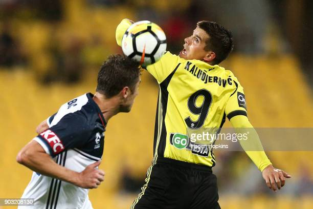 Andrija Kaludjerovic of the Phoenix and Dino Djulbic of the Victory compete for a header during the round 15 ALeague match between the Wellington...