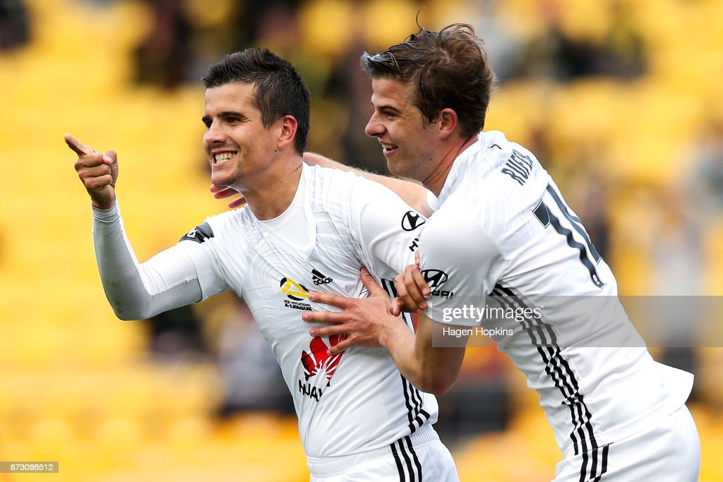 Andrija Kaludjerovic of the Phoenix celebrates with Alex Rufer after scoring a goal during the round six A-League match between the Wellington Phoenix and the Perth Glory at Westpac Stadium on November 12, 2017 in Wellington, New Zealand.