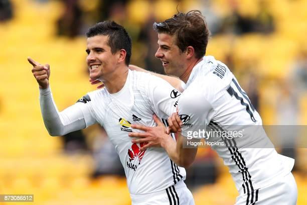 Andrija Kaludjerovic of the Phoenix celebrates with Alex Rufer after scoring a goal during the round six ALeague match between the Wellington Phoenix...