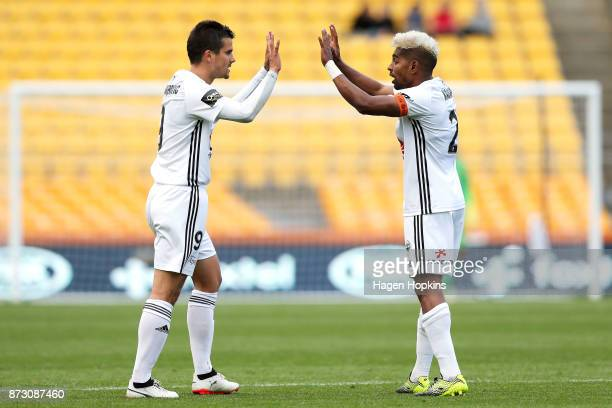Andrija Kaludjerovic of the Phoenix celebrates with Roy Krishna after scoring a goal during the round six ALeague match between the Wellington...