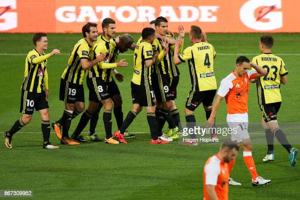 Andrija Kaludjerovic of the Phoenix celebrates with teammates after scoring a goal during the round four ALeague match between the Wellington Phoenix...