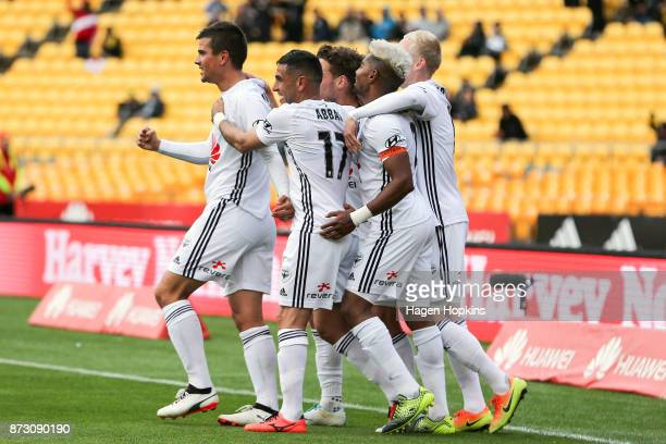 Andrija Kaludjerovic of the Phoenix celebrates with teammates after scoring a goal during the round six ALeague match between the Wellington Phoenix...