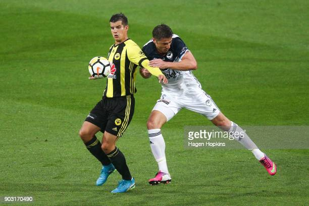 Andrija Kaludjerovic of the Phoenix controls the ball under pressure from Dino Djulbic of the Victory during the round 15 ALeague match between the...