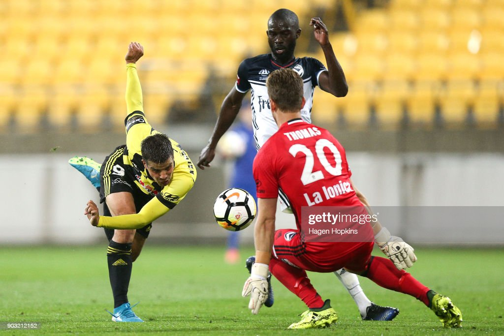 Andrija Kaludjerovic of the Phoenix loses his footing in the challenge of Jason Geria and Lawrence Thomas of the Victory during the round 15 A-League match between the Wellington Phoenix and Melbourne Victory at Westpac Stadium on January 10, 2018 in Wellington, New Zealand.
