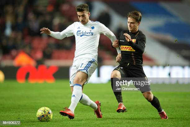 Andrija Pavlovic of FC Copenhagen and Mathias Jensen of FC Nordsjalland compete for the ball during the Danish Alka Superliga match between FC...