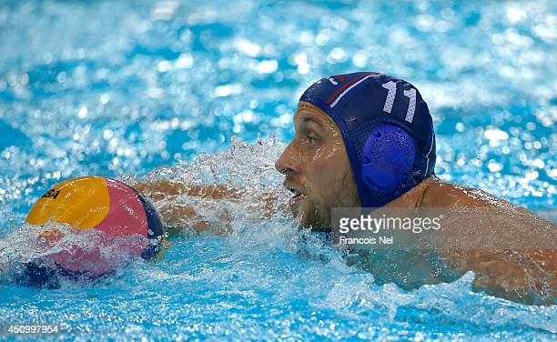 Andrija Prlainovic of Serbia in action during the Fina Men's Water Polo World League Super Final match between Hugary and Serbia at the Hamdan Sports...
