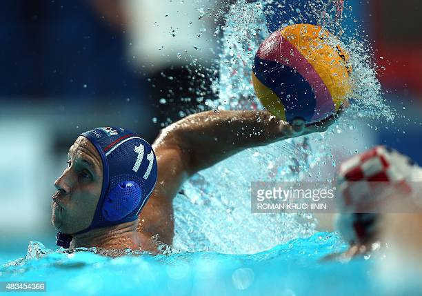 Andrija Prlainovic of Serbia throws the ball during the men's final water polo match between Croatia and Serbia on day fifteen of the 16th FINA World...