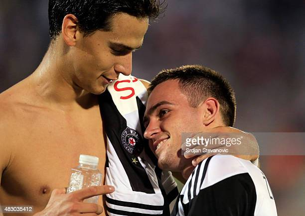 Andrija Zivkovic and Marko Jevtovic of FC Partizan Belgrade celebrate victory after the UEFA Champions League Third Qualifying Round Second Leg match...