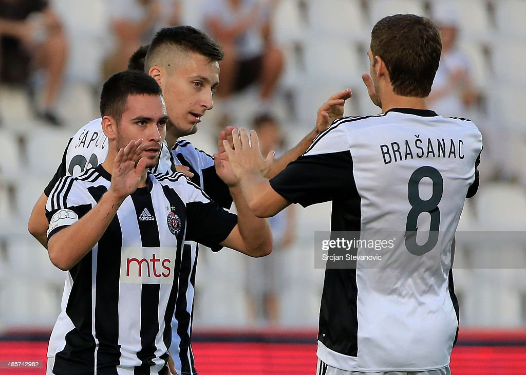 BELGRADE, SERBIA - AUGUST 29. Andrija Zivkovic (L) celebrates a goal with the Darko Brasanac (R) of FK Partizan during the Serbia Super League match between FK Partizan and OFK Belgrade at Partizan stadium in Belgrade, Serbia on Saturday, August 29, 2015.
