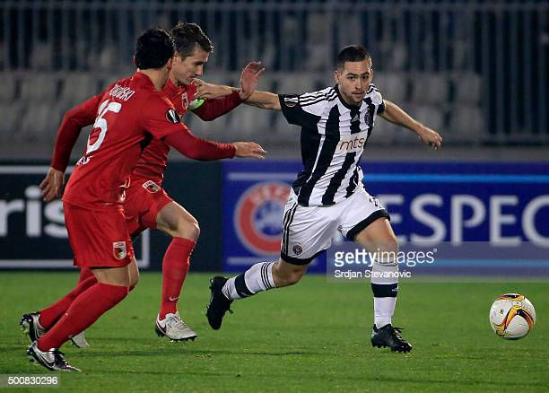 Andrija Zivkovic of FK Partizan in action against Paul Verhaegh of FC Augsburg during the UEFA Europa League match between FK Partizan v FC Augsburg...