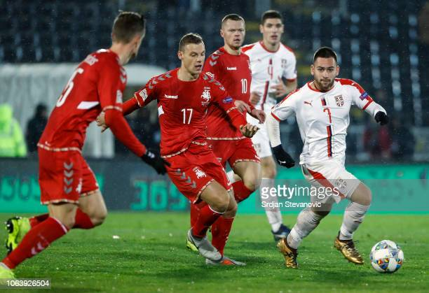 Andrija Zivkovic of Serbia in action against Giedrius Matulevicius of Lithuania during the UEFA Nations League C group four match between Serbia and...