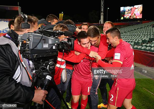 Andrija Zivkovic of Serbia is mobbed by team mates after scoring the opening goal during the FIFA U20 World Cup Semi Final match between Serbia and...