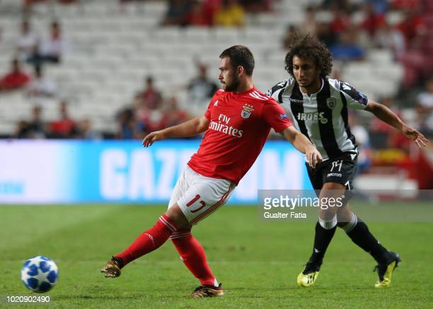 Andrija Zivkovic of SL Benfica with Amr Warda of PAOK in action during the UEFA Champions League Play Off match between SL Benfica and PAOK at...