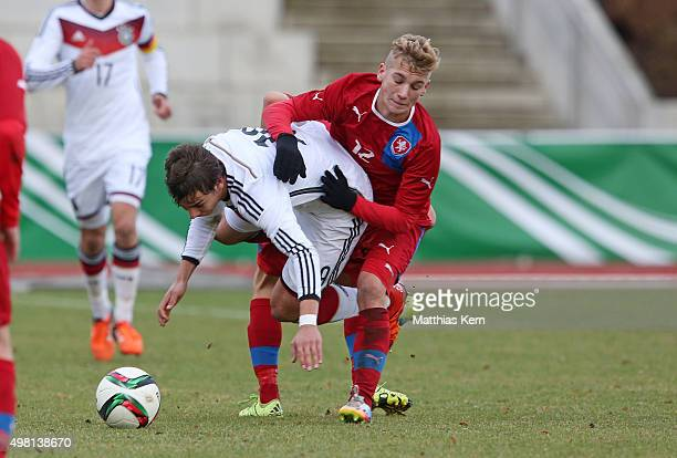 Andriko Smolinski of Germany battles for the ball with Martin Vybiral of Czech Republic during the U16 international friendly match between Germany...