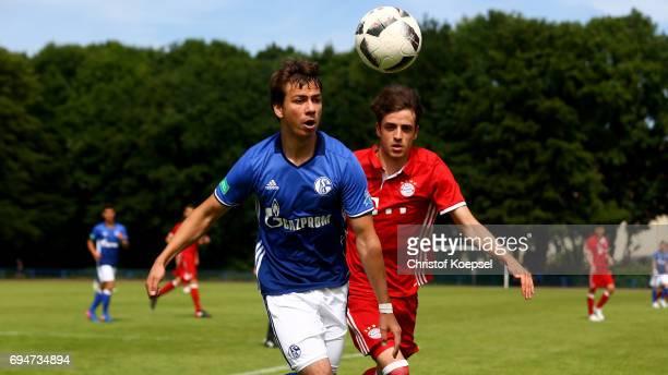 Andriko Smolinski of Schalke and Daniel Jelisic of Bayern go up for a header during the B Juniors German Championship Semi Final match between FC...