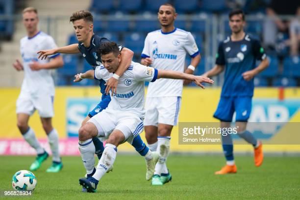 Andriko Smolinski of Schalke is challenged by Christoph Baumgartner of Hoffenheim during the German A Juniors Championship Semi Final Leg One match...