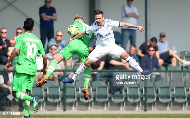 Andriko Smolinski of Schalke jumps for a header against Jonas Pfalz during the A Junior match between Moenchengladbach and FC Schalke 04 on April 21...
