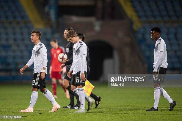 Andriko Smolinski Samuel Lengle and CharlesJesaja Herrmann of Germany react after the Germany U19 against Portugal U19 match of UEFA Four Nations...