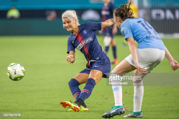Andrine Hegerberg left delivers a cross during the third place match of the Women's International Champions Cup between Manchester City and Paris...