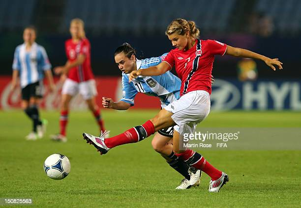 Andrine Hegerberg of Norway and Maria Bonsegundo of Argentina battle for the ball during the FIFA U20 Women's World Cup 2012 group C match between...