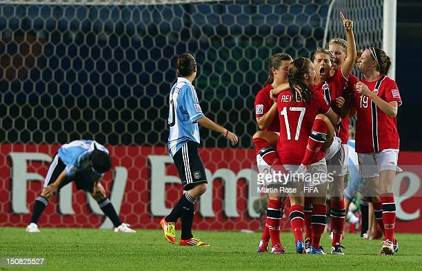 Andrine Hegerberg of Norway celebrate with her team mates after she scores her team's 3rd goal during the FIFA U20 Women's World Cup 2012 group C...