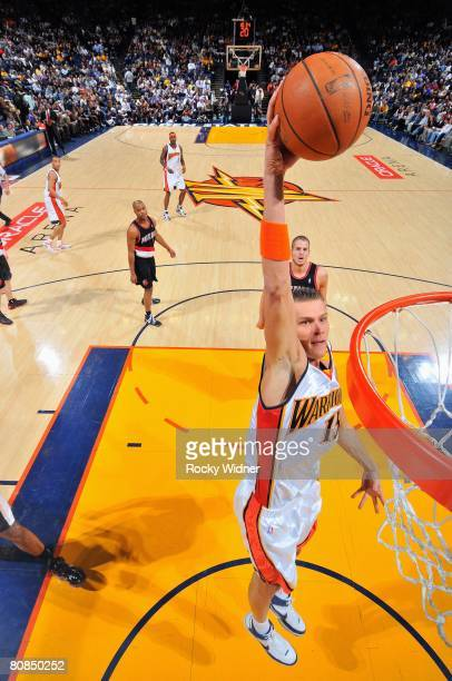 Andris Biedrins of the Golden State Warriors dunks against the Portland Trail Blazers during the game at Oracle Arena on March 27 2008 in Oakland...