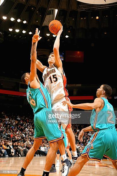 Andris Biedrins of the Golden State Warriors goes up for the shot against Tyson Chandler #6 of the New Orlean/Oklahoma Hornets on December 9 2006 at...